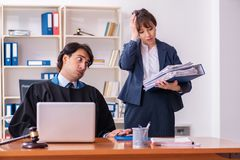 The two lawyers working in the office stock photo