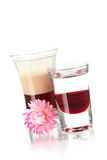 Two layered shot cocktails with flower Royalty Free Stock Image