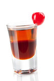 Two layered shot with maraschino Stock Image