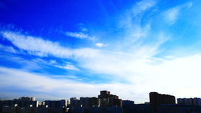 Two layers of clouds over the city. Clouds floating over the city stock video footage