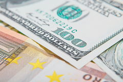 Two leading hard currencies - US Dollar and Euro. Background Royalty Free Stock Photos