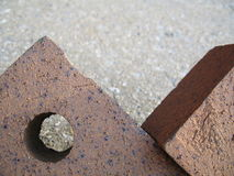 Two Leaning Bricks Abstract. Good as a background stock photography
