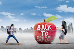 Two learners and apple with text of back to school Stock Photos