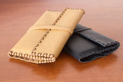 Two Leather Tobacco Pouches. Yellow and black made of natural leather for tabacco bags Royalty Free Stock Image