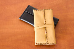 Two Leather Tobacco Pouches. Yellow and black made of natural leather for tabacco bags Stock Photography