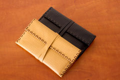 Two Leather Tobacco Pouches. Yellow and black made of natural leather for tabacco bags Stock Image
