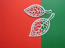 Two leaves cut from white paper Royalty Free Stock Images