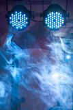 Two led blue concert and nightclub lights with smoke Stock Photos