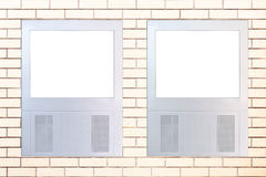 Two led displays on brick wall Stock Image