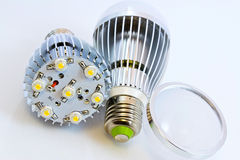 Two LED light bulbs with 1 Watts SMD chips. One of them  without cover glass Royalty Free Stock Photo