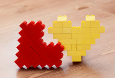 Two lego hearts. On the table royalty free stock image