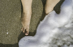 Two legs in sea waves Royalty Free Stock Photo