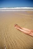 Two legs in water at Conil beach Royalty Free Stock Photo