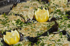 Two lemon decoratively trimmed teeth on a dish of eggplant with mayonnaise and parsley. Beer-Sheba, 18 March, Negev Israel Royalty Free Stock Photo