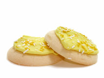 Two Lemon Frosted & Sprinkled Sugar Cookies Royalty Free Stock Images