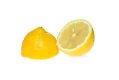Two lemon halves. Isolated on the white background Royalty Free Stock Photos