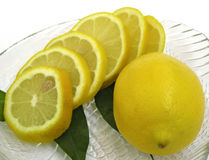 Two lemons. On crystal plate Stock Images