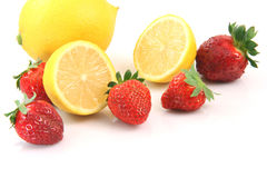 Two lemons and berries Stock Image