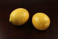 Two lemons on black background Royalty Free Stock Photography