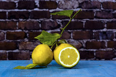Two Lemons on a blue wood Royalty Free Stock Images