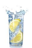Two lemons fell in a glass. With water isolated on white Royalty Free Stock Photo
