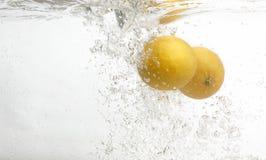Two Lemons In Fresh Water. Royalty Free Stock Photos