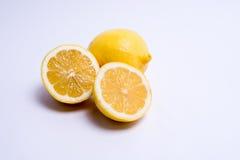 Two lemons isolated on white. Closeup of lemon isolated on white background. Selective focus Stock Images