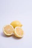Two lemons isolated on white. Closeup of lemon isolated on white background. Selective focus Stock Image