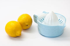 Two lemons and lemon squeezer Royalty Free Stock Image