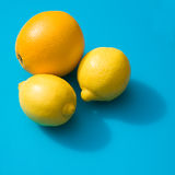 Two lemons and an orange Stock Photos