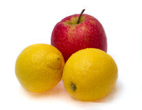 Two lemons and red apple Stock Image