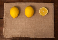 Two lemons and a slice Royalty Free Stock Images