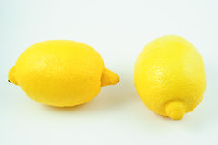 Two lemons on white background Stock Photos