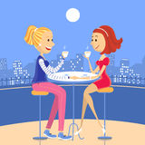 Two lesbian lovers in a cafe Royalty Free Stock Photography