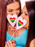 Two lesbian women with heard  in erotic foreplay Royalty Free Stock Photography
