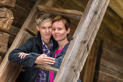 Two lesbians. Two girls posing together in old wooden building, horizon format Stock Photos