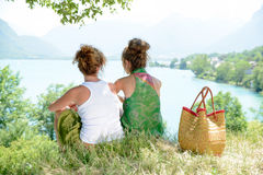 Two lesbians in nature admire the landscape stock images