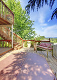 Two level backyard deck with bench and hot tub for enjoyment on the first level. Stock Photography