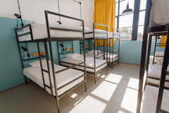 Two-level beds inside a modern hotel for young tourists and students Royalty Free Stock Images