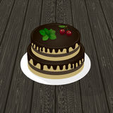 Two-level biscuit chocolate cake with mint sprig and cherries on a plate. wood texture in the background. Two-level biscuit chocolate cake with mint sprig and Royalty Free Stock Photography