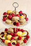 Two level dessert stand full of sweets Stock Images