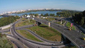 Flying above round road junction. Two-level   road junction on the Paton Bridge in Kyiv stock footage