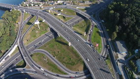 Flying above round road junction. Two-level   road junction on the Paton Bridge in Kyiv stock video footage