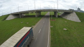 Two Level Traffic Road Interchange Big Truck Moves along Lane stock footage