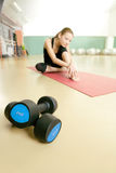 Two lie dumbbells Royalty Free Stock Images