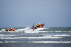 Two Lifeboat  launch into the sea. Royalty Free Stock Photography