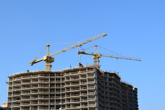 Two lifting crane and building under construction. Stock Images
