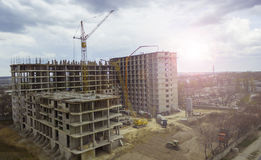 Two lifting crane and building under construction.  Stock Image