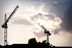 Two lifting cranes Stock Photography