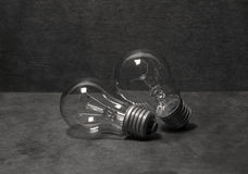 Two light bulbs. Two light bulbs laying on a wooden table Stock Photo